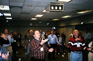Seminar attendees participating in a juggling exercise.